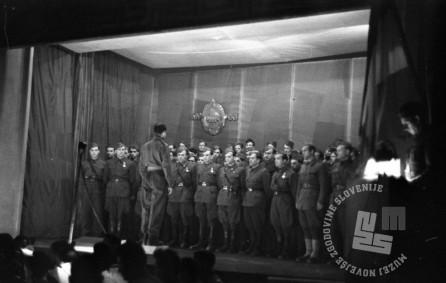 894_12: Proslava II. obletnice KNOJ-a v Črnomlju. Nastop invalidskega pevskega zbora, 17. marec 1945, foto: Franci Cerar