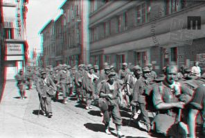 FS2262_11a: Kolona nemških vojnih ujetnikov na ulici v Celju, 12. maj 1945. Foto: Jože Kološa. A troop of German prisoners of war in a street in Celje, May 12th, 1945. Photo: Jože Kološa.
