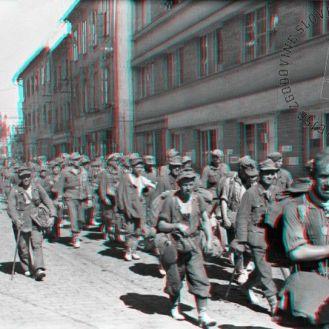FS2262_11a: Kolona nemških vojnih ujetnikov na ulici v Celju, 12. maj 1945. Foto: Jože Kološa. A troop of German prisoners of war in a street in Celje, May 12th, 1945. Photo: Jože Kološa.