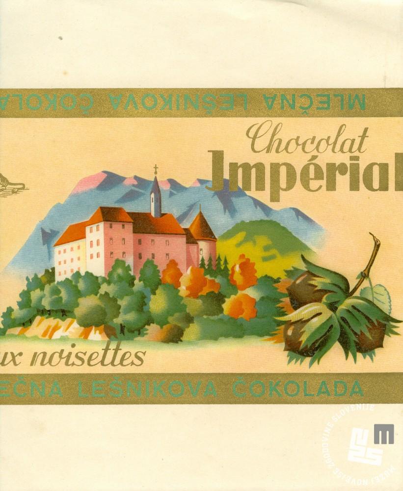 Originalni, štokartiran ovitek trapistovske čokolade. Hrani MNZS.