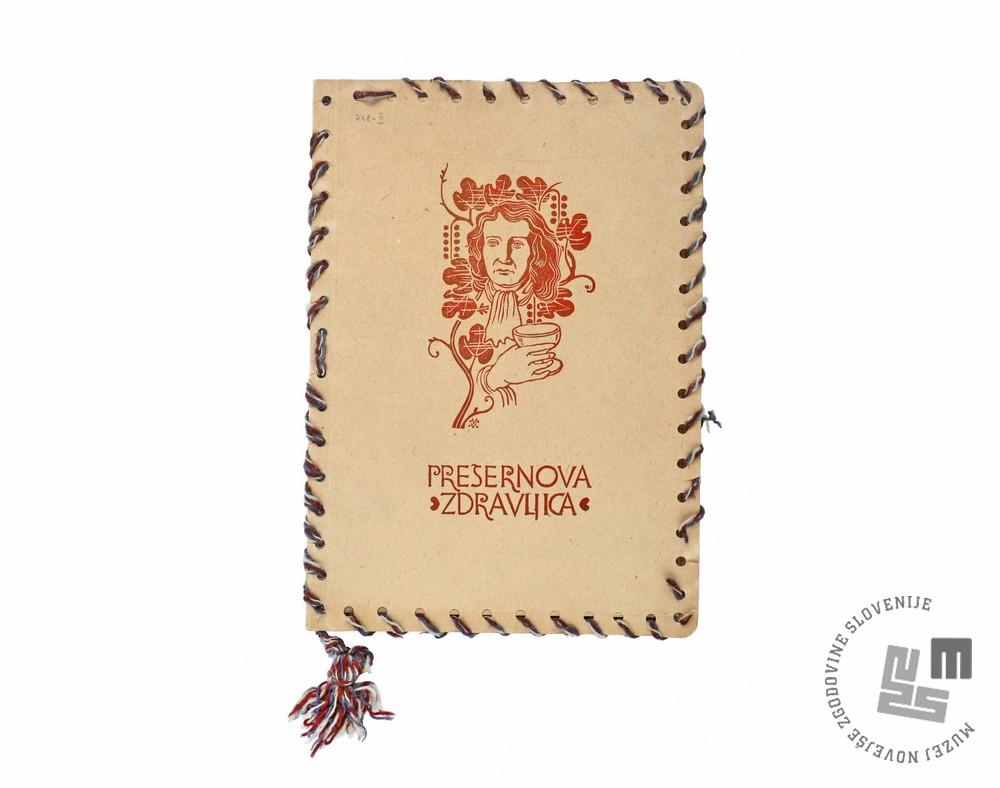 Prešernova Zdravljica 1944 Prešeren, France (1800–1849); linorezi Vidic, Janez (1923–1996); vinjete Šorli, Marjan (1915–1975)  izdal Pokrajinski odbor Osvobodilne fronte za Gorenjsko tiskarna Trilof, Davča papir, volna; 30,1 x 21,3 cm; 18 f. bibliofilska izd., št. 155 inv. št. 300000222